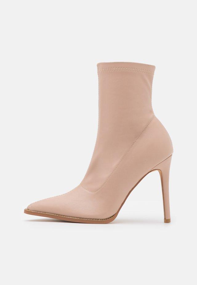 DIAMANTE STILETTO SOCK BOOT - Classic ankle boots - nude