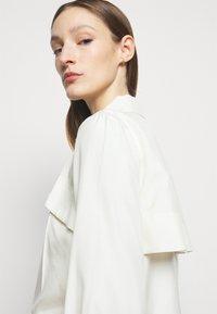 Victoria Beckham - FUNNEL NECK  - Button-down blouse - off white - 5