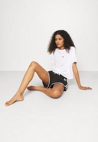 Calvin Klein Swimwear - CORE LOGO TAPE - Bikini bottoms - black - 4