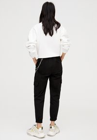 PULL&BEAR - CARGO - Trousers - black - 2