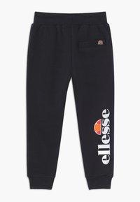 Ellesse - MARTHA - Pantalon de survêtement - black - 1
