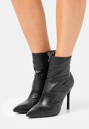 JULIANA - Kotníková obuv na vysokém podpatku - black