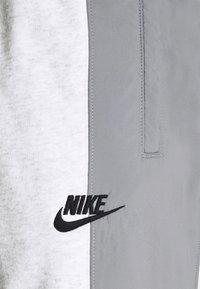 Nike Sportswear - Tracksuit bottoms - birch heather/particle grey/particle grey/black - 5