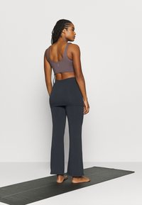 Curare Yogawear - PANTS SKIRT - Tracksuit bottoms - midnight blue - 2