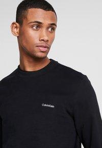 Calvin Klein - LOGO EMBROIDERY - Felpa - black - 4