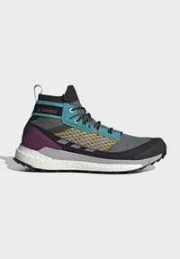 adidas Performance - FREE HIKER BOOST PRIMEKNIT HIKING SHOES - Neutral running shoes - green - 7