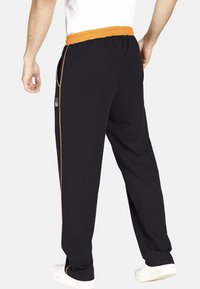 Jan Vanderstorm - RENTIUS - Tracksuit bottoms - black - 1