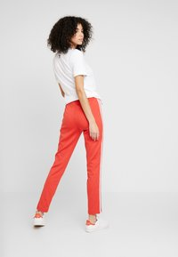 adidas Originals - SUPERSTAR SUPER GIRL ADICOLOR TRACK PANTS - Spodnie treningowe - lush red/white - 2