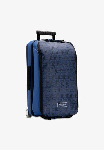 Wheeled suitcase - rich cobalt monogram