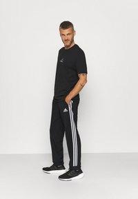 adidas Performance - Pantalon de survêtement - black - 1