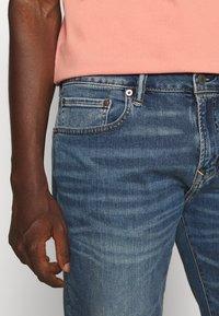 American Eagle - ATHLETIC DARK WASH - Straight leg jeans - blue denim - 3