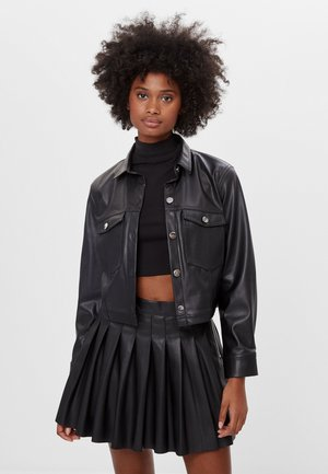 GLÄNZENDES HEMD - Faux leather jacket - black
