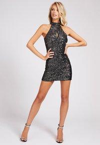 Guess - HOHER KRAGEN PAILLETTEN - Cocktail dress / Party dress - schwarz - 0