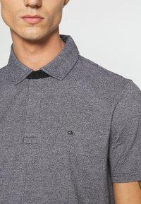 Calvin Klein - LIQUID HEATHER - Polo shirt - black - 5