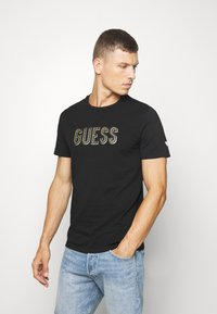 Guess - DEAL TEE - Printtipaita - jet black - 0