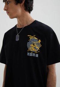 PULL&BEAR - STWD-SLOGAN - Print T-shirt - black - 4