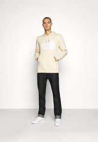 The North Face - STANDARD HOODIE - Huppari - bleached sand - 1