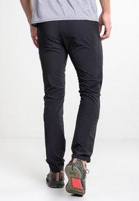 Luhta - AJOLA - Outdoor trousers - black - 2