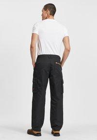 Timberland - ECORIGINAL EK - Cargo trousers - black - 1