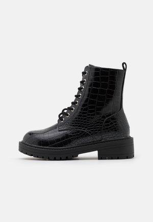 ALBERTA - Platform ankle boots - black
