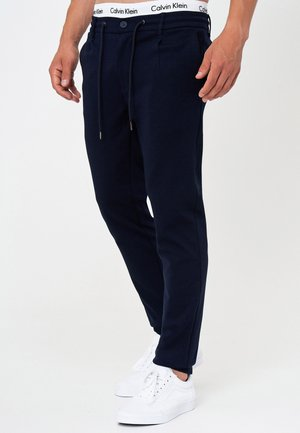 SUPER STRETCH DYER - Trousers - navy