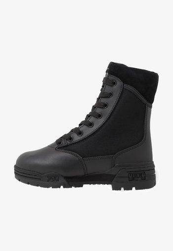 MID - Hiking shoes - black