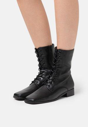 JOVI - Šněrovací kotníkové boty - black