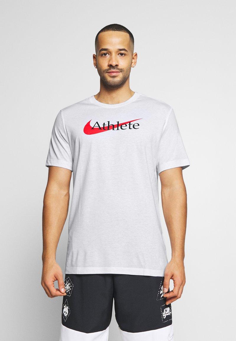 Nike Performance - TEE ATHLETE - Camiseta estampada - white/university red