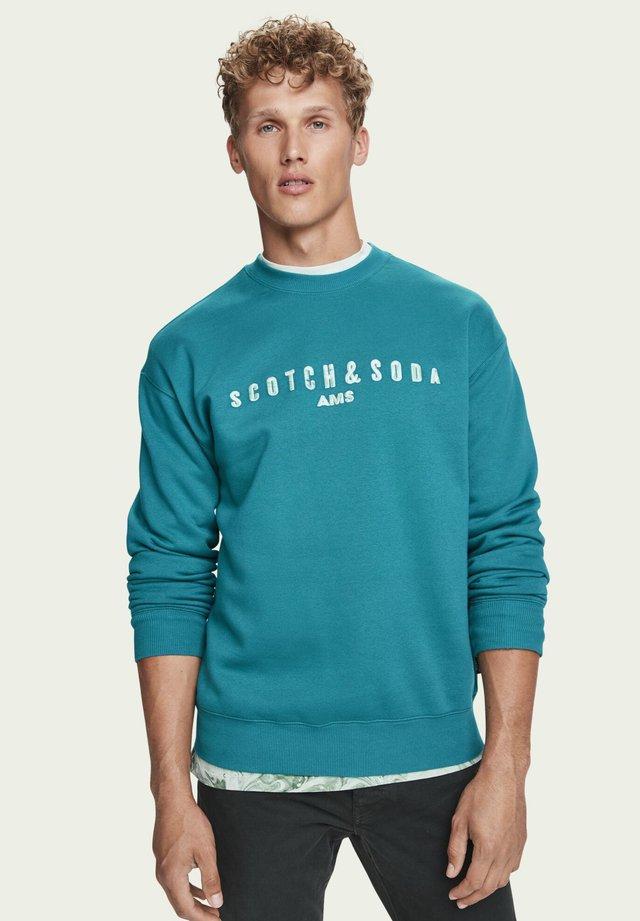 ARTWORK - Sweater - glacier green