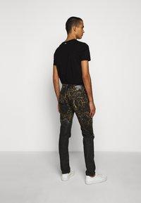 Just Cavalli - PANTS POCKETS LEOPARD PRINT - Džíny Slim Fit - black - 2