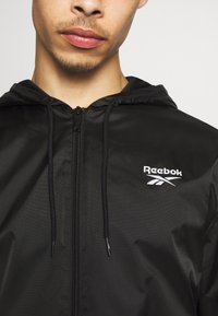 Reebok Classic - VECTOR WINDBREAKER - Summer jacket - black - 5