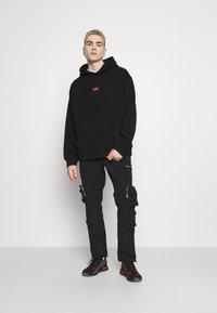 Weekday - RICHARD LABELED HOODIE - Sweatshirt - black - 1