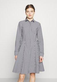 Steffen Schraut - EXCLUSIVE BLOUSE DRESS - Shirt dress - black/white - 0