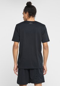 Under Armour - T-shirts print - black/white - 2