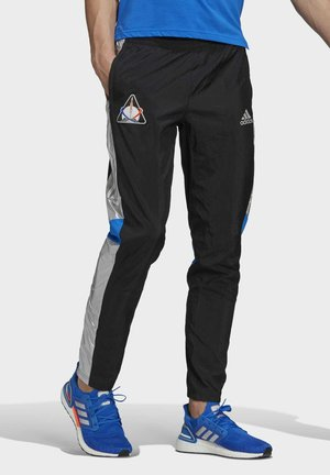 SPACE PANTS RUNNING - Tracksuit bottoms - black