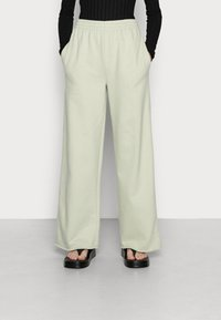 EDITED - SYLVIA TROUSERS - Tracksuit bottoms - desert sage green - 0