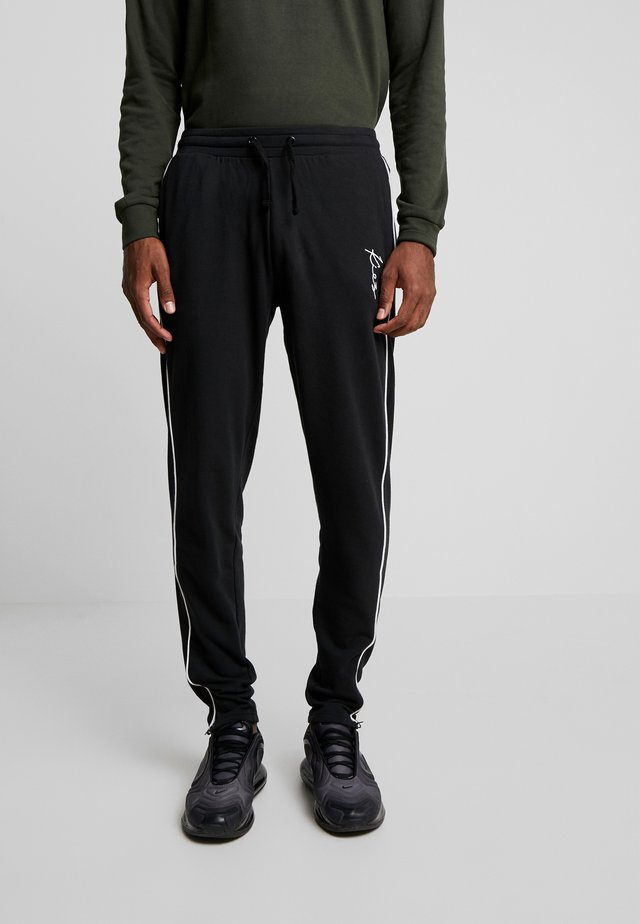 SKINNY TRACKPANTS - Tracksuit bottoms - black