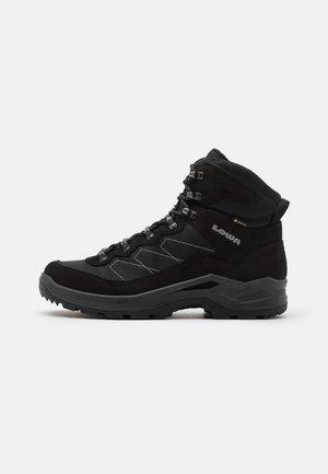 TAURUS PRO GTX MID - Hiking shoes - black