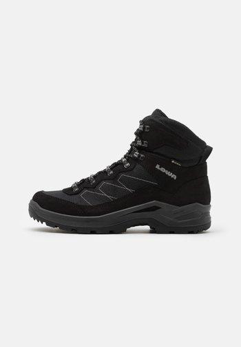 TAURUS PRO GTX MID - Chaussures de marche - black