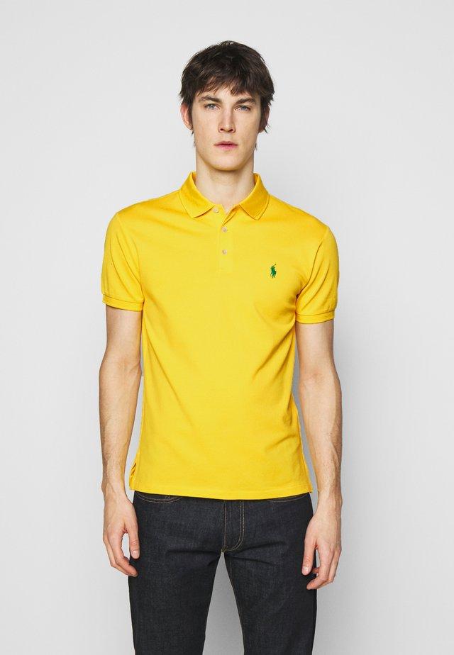 SLIM FIT - Polo shirt - racing yellow