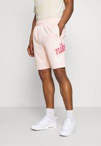 Nike SB - SUNDAY UNISEX - Tracksuit bottoms - orange pearl/coconut milk - 0