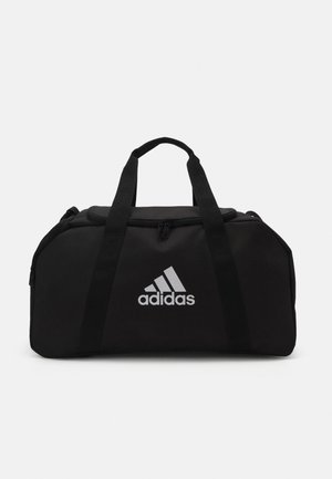 TIRO DU S - Sports bag - black/white