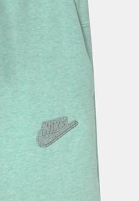 Nike Sportswear - REGRIND UNISEX - Tracksuit bottoms - light dew - 2