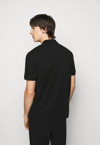 HUGO - DONOS - Polo shirt - black - 2