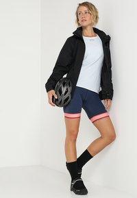 Vaude - WOMENS ESCAPE BIKE LIGHT JACKET - Waterproof jacket - black - 1