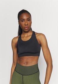 Casall - CROSSBACK  - Medium support sports bra - black - 0