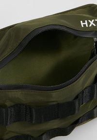 HXTN Supply - UTILITY TAPER CROSSBODY - Bum bag - olive - 4