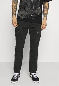Tigha - FRYCO - Cargo trousers - vintage black - 0