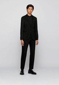 BOSS - DIBARI - Polo shirt - black - 1