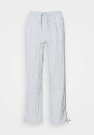 TIE CUFF - Tracksuit bottoms - baby blue